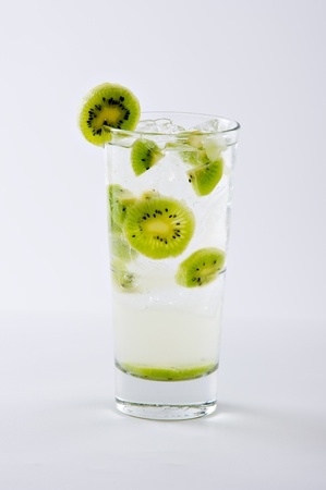 tom collins: A true classic...kiwi collins cocktail with gin, kiwi and tonic water.  studio shot