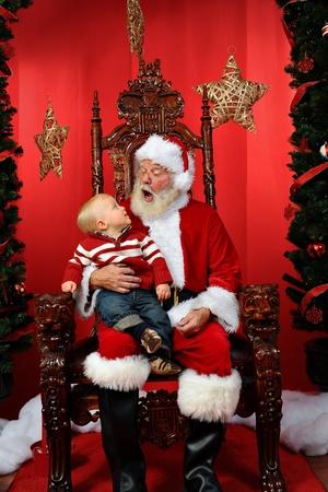 12 15 months: Baby boy sitting on Santa
