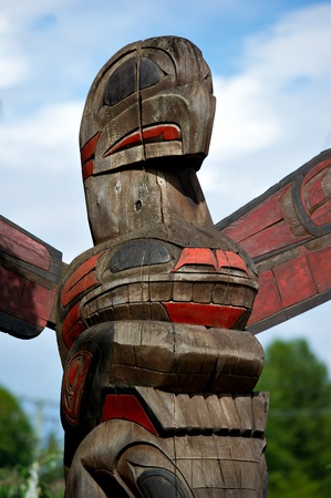 the totem pole: Detail of a totem pole located in Duncan, British Columbia.  Colorful representation of an Eagle.