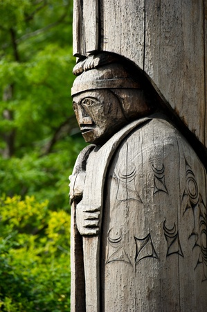 vancouver island: Detail of a totem pole located in Duncan, British Columbia. Wood carving representation of a person.