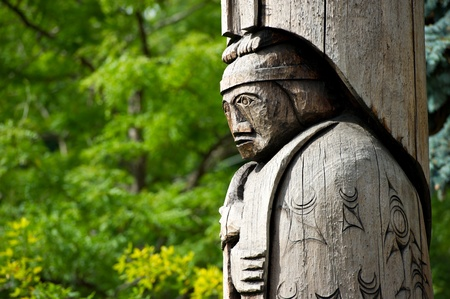Detail of a totem pole located in Duncan, British Columbia. Wood carving representation of a person. Editorial