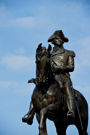 The George Washington statue at the Public Garden in Boston, MA against a blue sky with plenty of copy space.  photo