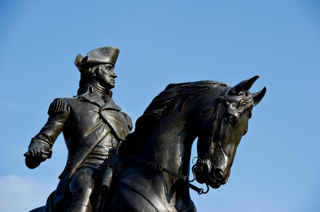 american revolution: The George Washington statue at the Public Garden in Boston, MA against a blue sky with plenty of copy space.