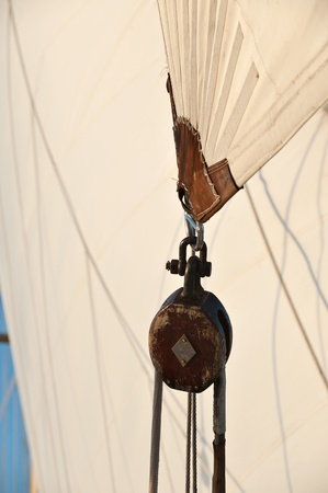 pulley: Pulley block.  Detail of a passenger cruise ship sailing in the Society Islands, Tahiti.