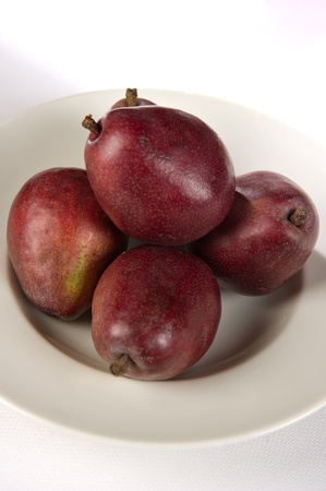 White bowl containing 5 red Anjou pears. Stock Photo - 12424500