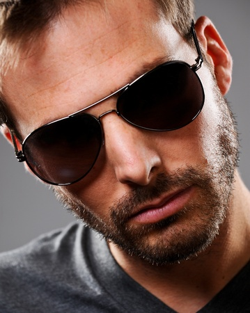 Portrait of an attractive young man with wearing dark sunglasses. Stock Photo - 12424596