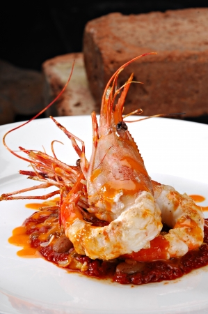 jumbo shrimp: Jumbo shrimp beautifully plated over a bed of red beans