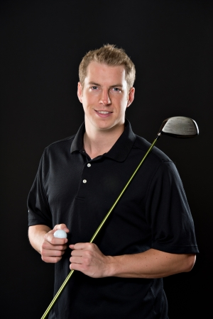 man front view: Portrait of a young male model in golf attire, holding a driver.
