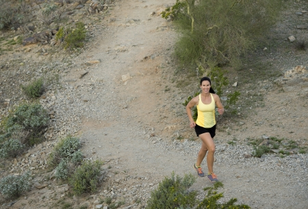 south park: Young woman trail running outdoors at South Mountain Park in Phoenix, Arizona.