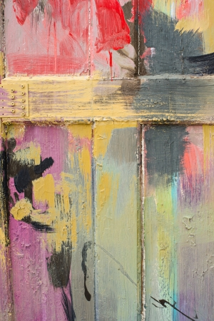 painted lines: Detail of a brightly painted wooden fence.