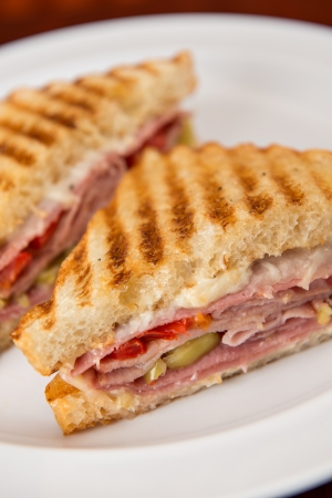 An Italian deli classic ham salami and provolone sandwich on sourdough bread.
