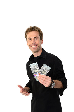 A young handsome man holding a lot of new hundred dollar bills isolated on white background.  This newly redesigned US currency was released for circulation in October of 2013. photo