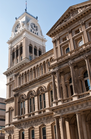 The Clock Tower and Old City Hall in Louisville, Kentucky against the day's blue sky. photo