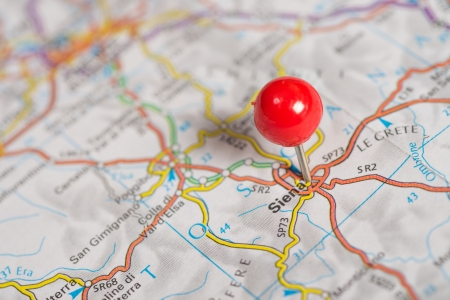 map pin: Close-up of red pushpin on the map.