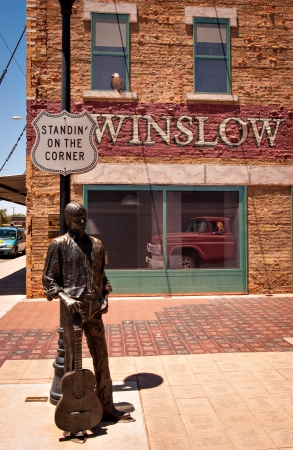 popularized: WINSLOW, AZUSA - June 13: Standin On The Corner Park, pays homage to Take It Easy, a song written by Jackson Browne and popularized by the rock group Eagles, on June 13, 2004, in Winslow, Arizona.