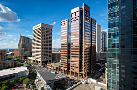 PHOENIX, USA - FEBRUARY 4: View of skyscrapers taken from the top of a CityScape Phoenix building on the corner of Washington and Central on February 4, 2014 in Phoenix, Arizona. Washington Street and Central Avenue is the heart of Downtown Phoenix, Arizo Editorial