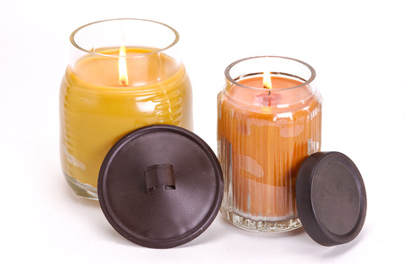 Assortment of decorative scented candles shot on a white background.