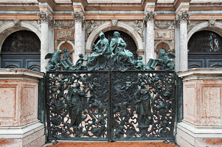 venetian: Bronze statues on a gate leading to San Marco Campanile, Venice, Italy Stock Photo