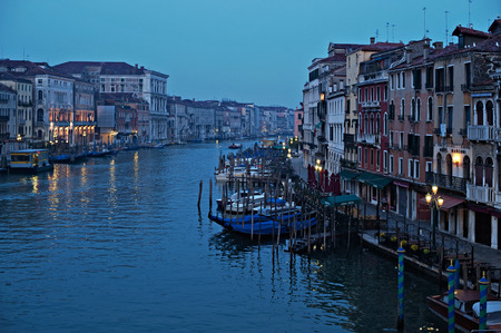 rialto: View of the Grand Canal from the Rialto Bridge with gondolas at sunset in Venice, Italy.