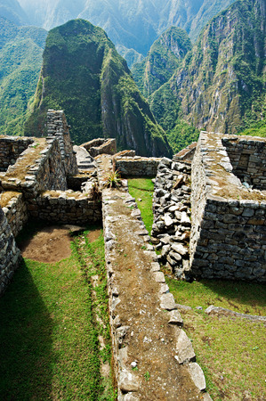 incan: Incan style masonry structures at Machu Picchu in Peru.
