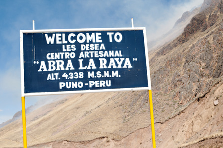 andean: Sign of Abra la raya, Peru.  The high mountain pass between Puno and Cusco.
