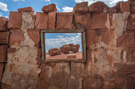 dweller: Native American home in Cliff Dwellers, located in Northern Arizona at Marble Canyon and at the foot of Vermillion Cliffs, is known for its unique shaped boulders and rugged terrain.
