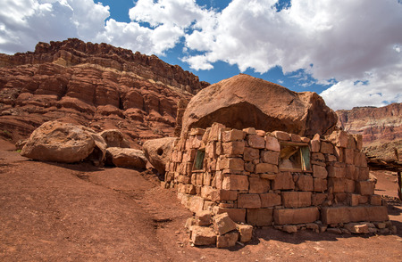 rugged terrain: Native American home in Cliff Dwellers, located in Northern Arizona at Marble Canyon and at the foot of Vermillion Cliffs, is known for its unique shaped boulders and rugged terrain.