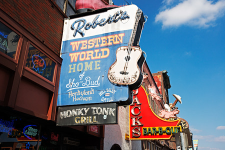 NASHVILLE - MARCH 23: Robert's Western World and Jacks Bar-B-Que sign on Lower Broadway Area on March 23, 2014 in Nashville, Tennessee, USA.  These restaurants are local food landmarks.