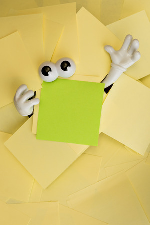 sticky hands: Hands reach out and eyes peer out from under several bright yellow sticky notes and a green one as well.