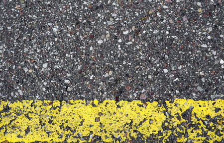 yellow line: Detail of asphalt road with yellow line