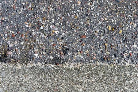 asphalt paving: Rough asphalt structure with many colorful stones and concrete