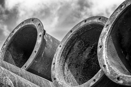 Many industrial old rusty steel pipes on the sky. Stock Photo