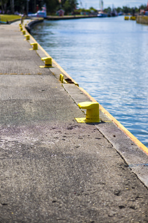 bollards: Yellow bitt on port channel quayside mooring