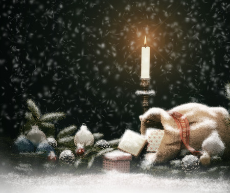 jute sack: Christmas Composition. Gift Boxes with Candle, Balls, Cones and Jute Sack.  Vintage Style with Drawn Snowfall.
