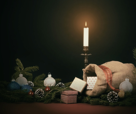 sacco juta: Christmas background with  jute sack and gift boxes, fir branches, baubles and cones. Vintage Style.