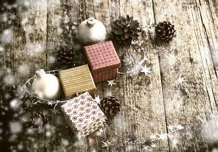 festive pine cones: Festive Gifts with Boxes, Baubles, Pine Cones on Wooden Background. Christmas Decoration in Vintage Style