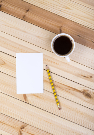 scribbling: Blank Small Notepad, Cup Of Coffee And Pencil On Wooden Table. Stock Photo