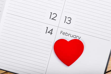 14: Red Wooden Heart On Calendar. February 14. Valentines Day Concept