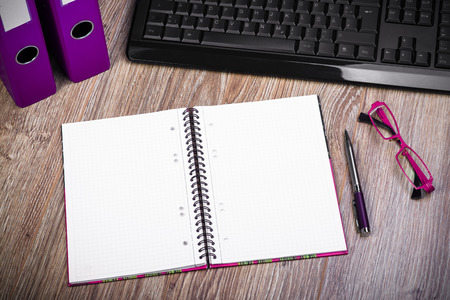 ring binders: View Of An Office Desk With Keyboard, Ring Binders, Glasses, Notepad And Pen. Stock Photo
