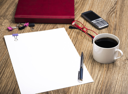 scribbling: View Of An Office Desk With Calendar, Cell Phone, Coffee Cup, Sheet Of Paper For Notice, Glasses And Pen. Stock Photo