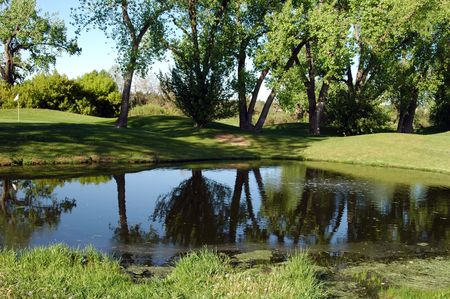 A beautiful water trap on a golf course Stock Photo