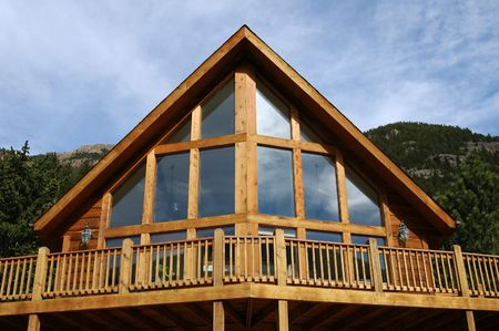 An a-frame cabin in the mountains Stock Photo