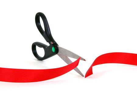 Scissors cutting through red tape