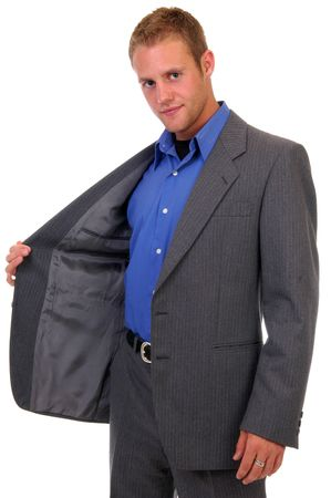 jacked: A young man holding his suit jacked open