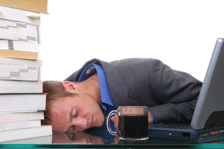 passed out: An overworked man passed out at his desk Stock Photo