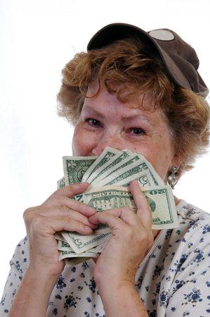 現金の一握りの幸せな女 写真素材