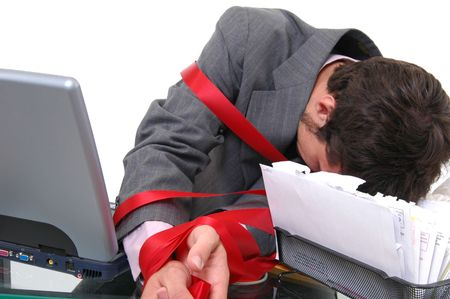 A businessman tied up in red tape