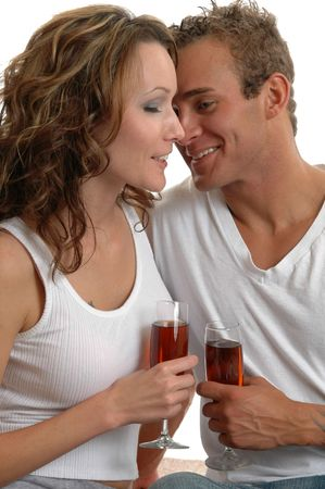 thier: A loving young couple enjoying  wine in thier home