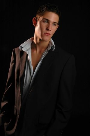 'evening wear': A handsome young man in stylish evening wear Stock Photo