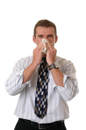 sniffles: A businessman holding a tissure to his nose while he sneezes Stock Photo